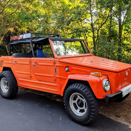 Rent and ride this orange dune buggy on the Outer Banks, North Carolina.